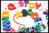 Lacing Alphabet Beads Busy Bag - Fine motor and early reading learning activity. Sort by shape and color. Travel activity