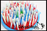 Toddler Fun - stacking straws on pegs