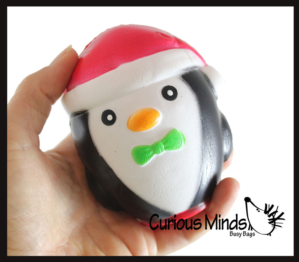 Large Penguin with Santa hat Slow Rise Squishy Toy - Memory Foam Squish Stress Ball - Winter Christmas