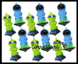 Wind Up Alien and Astronaut Launcher Spinning Top Toy