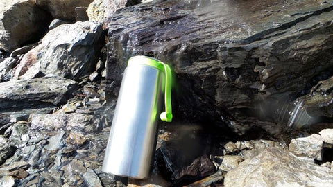 water-purifier-bottle-in-use-with-spring-water-french-alps