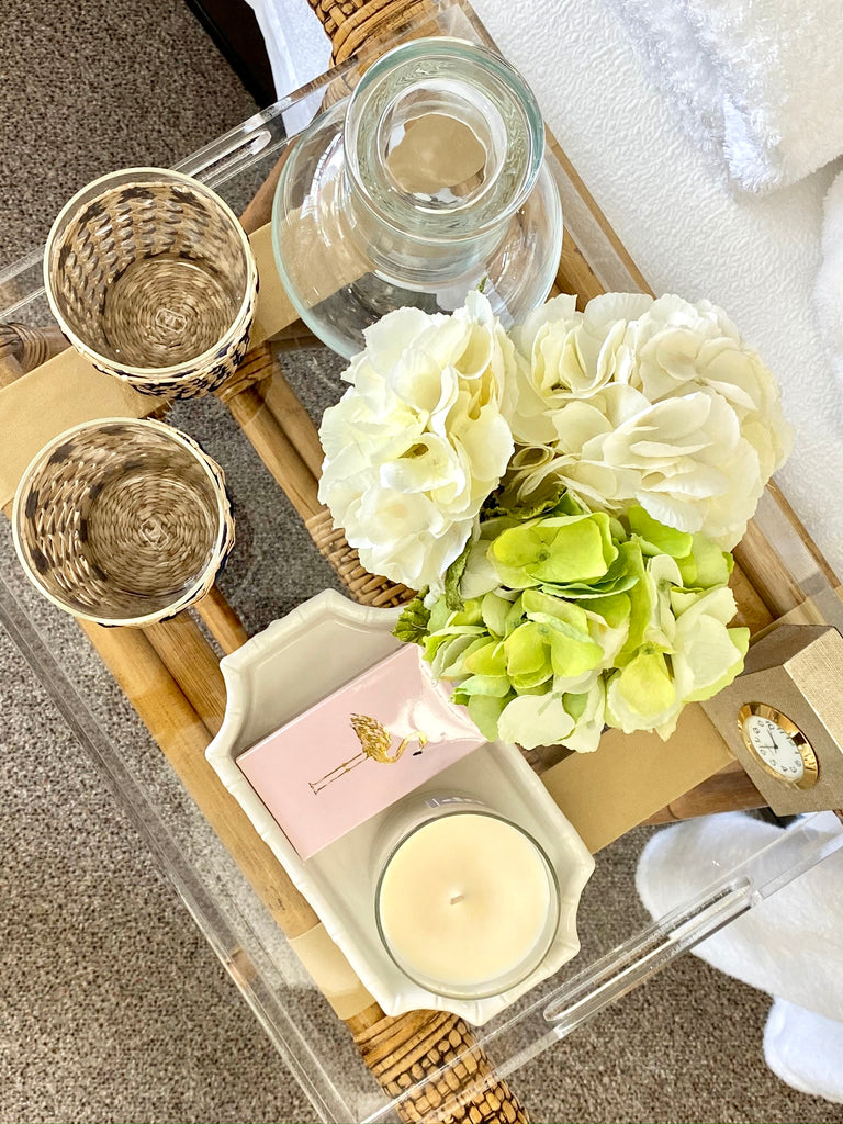 guest bedroom tray with glasses, flowers, candle and matches