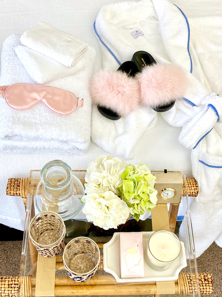 guest room essentials robe, tray, water cup, slippers, eye mask