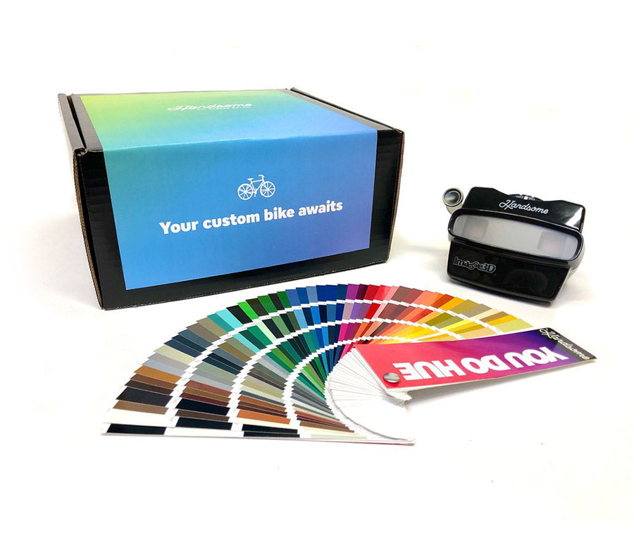 Image of custom color box. Containing a color swatch book and a headset.