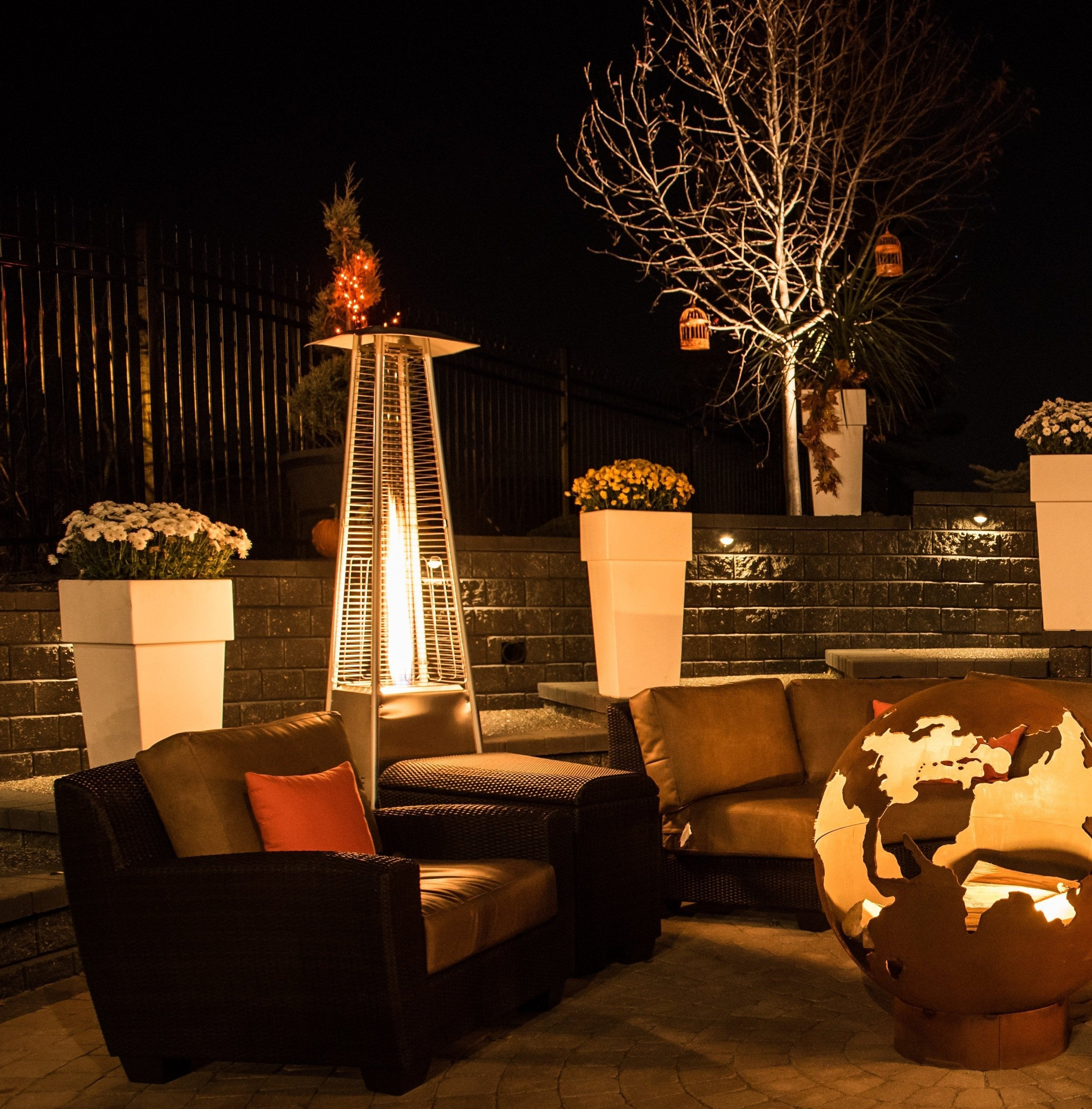 Patio furniture and heaters in backyard