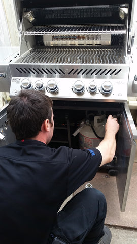 Technician Working On Barbecue