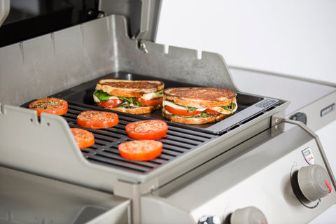 Toasted veggie sandwiches and tomatoes on griddle