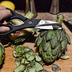 Using kitchen scissors, snip off the spikey parts of the artichokes