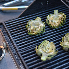 Transfer the artichokes to the preheated grill
