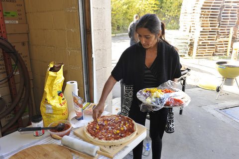 Radha getting her pizza ready for the grill
