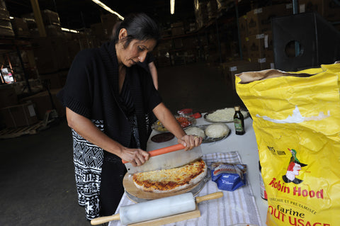 Radha getting the pizza cut and ready to eat