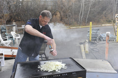 Mark grilling onions on the Brander Chuckwagon griddle