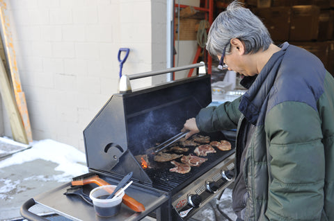 Sonny grilling Vietnamese pork at the Calgary North store.