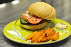 Grilled black bean burgers with sweet potato fries