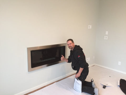 Barbecues Galore Fireplace Installer Phil installing a zero clearance gas fireplace