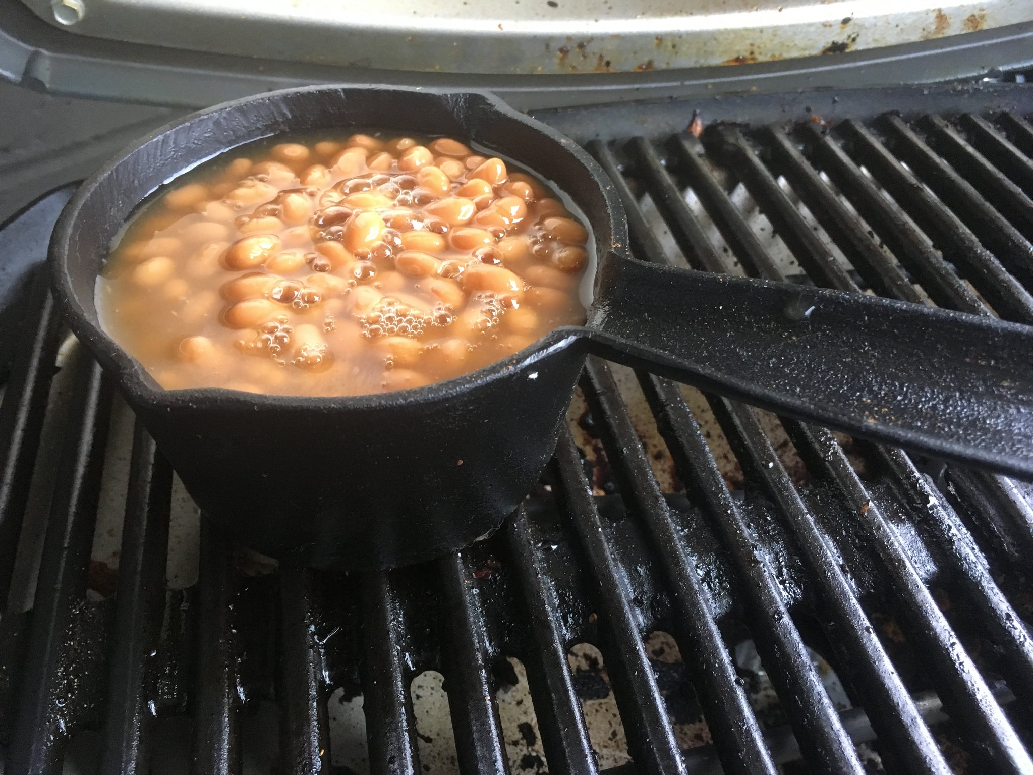Maple Baked Beans in a Cast Iron Pot on Barbecue