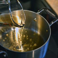 Pour the rye into a medium saucepan over high heat.