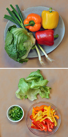 While the chicken is cooking, slice the peppers, separate and wash the lettuce leaves,