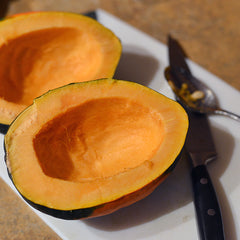 Cut your squash in half and scoop out the stringy innards and seeds