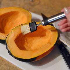 Brush the inside of the squash with the melted butter
