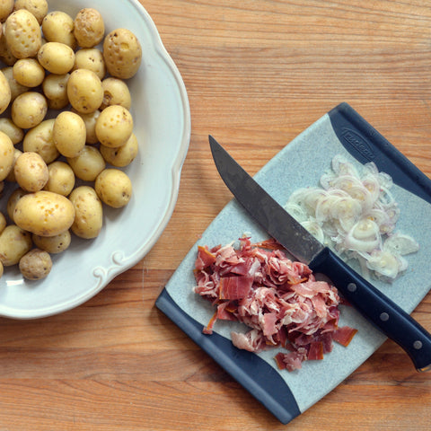 wash the potatoes and poke holes in them with a fork;