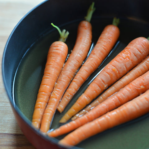 Place carrots in a shallow pot of boiling water; cook for about 5 minutes