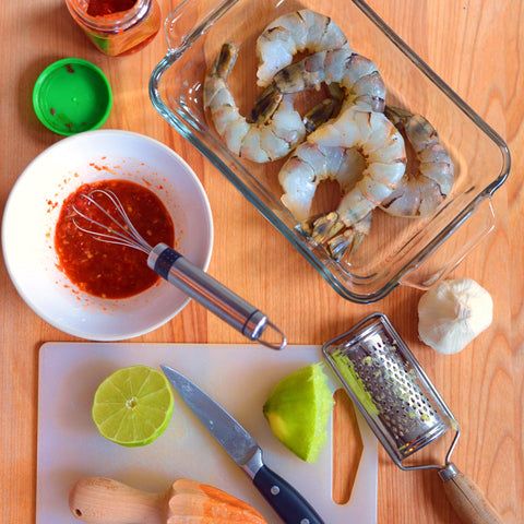 In a small bowl, whisk lime juice, Sambal Oelek, garlic, and ginger.