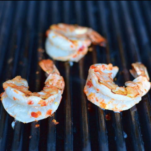 Preheat grill to medium heat and grease it well. Transfer the shrimp to the prepared grill and discard any excess sauce.
