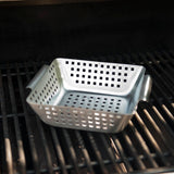 The stainless steel grilling wok saves you optimal space on your grill. Get those veggies grilled up without spreading them. Accessories like this space-saving basket, grill brushes, sauces, marinades and more are available at Barbecues Galore in Toronto and Calgary.