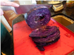 Remove cabbage from the barbecue and slice it up.