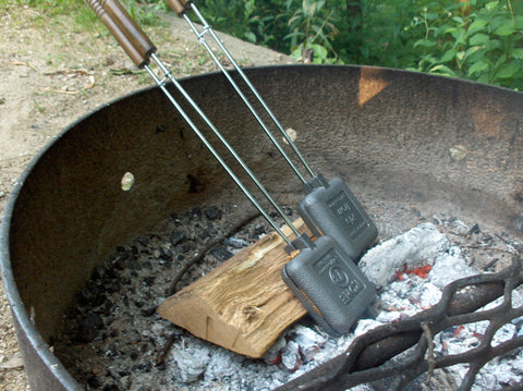 Rome Industries Pie Irons in a campfire.