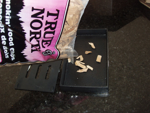 Fill up Smoker Box with Wood Chips