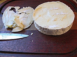 Cut the top rind off of the Brie