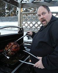 Nick using the rotisserie on a Napoleon bbq in the winter