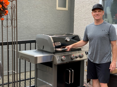 Customer showing off their new Weber Genesis II CSE-335 with lid closed | Barbecues Galore: Etobicoke, Oakville, Burlington & Calgary