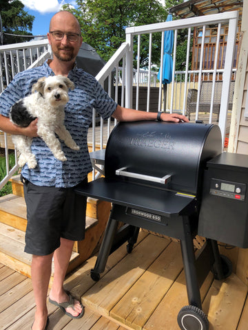 Customer and puppy excited to start grilling on their new Traeger Ironwood 650 Pellet BBQ.  Available at Barbecues Galore: Burlington, Oakville & Etobicoke, ON, and Calgary, AB.