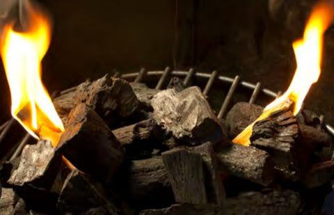 Fatwood All-Natural Firelighter Sticks lighting a Charcoal Grill | Barbecues Galore