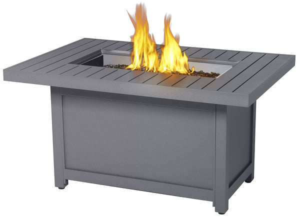 Napoleon Hampton Patio Flame Rectangular Fire Table is grey in colour with an overhanging tabletop. The tabletop is lain down with identical rectangular pieces side-by-side. This fire table can be bought at Barbecues Galore in Calgary, Alberta and the greater Toronto Area in Burlington, Oakville and Etobicoke.