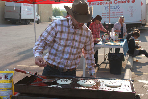 Trevor using the Chuckwagon Griddle for Stampede Breakfast