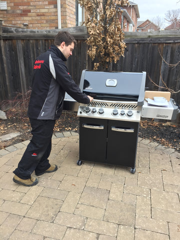 BBQ Butler Jordan placing the Napoleon P500RSIB Black in its new home in time for summer.  Available at Barbecues Galore: Burlington, Oakville, Etobicoke & Calgary