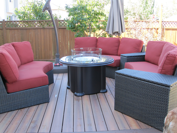 Outdoor Great Room Grand Colonial Fire Table shown with Glass Guard and Patio Renaissance Delmar Collection