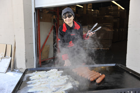 Sonya using the Chuckwagon Griddle for chicken and smokies