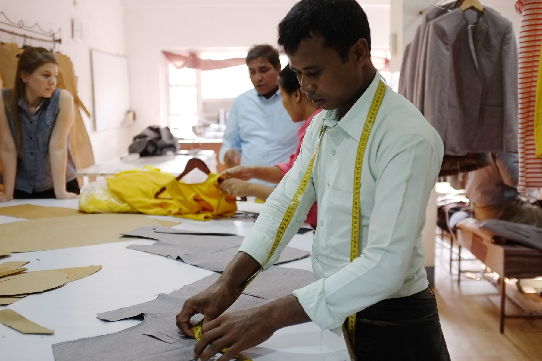 tailor measuring clothing