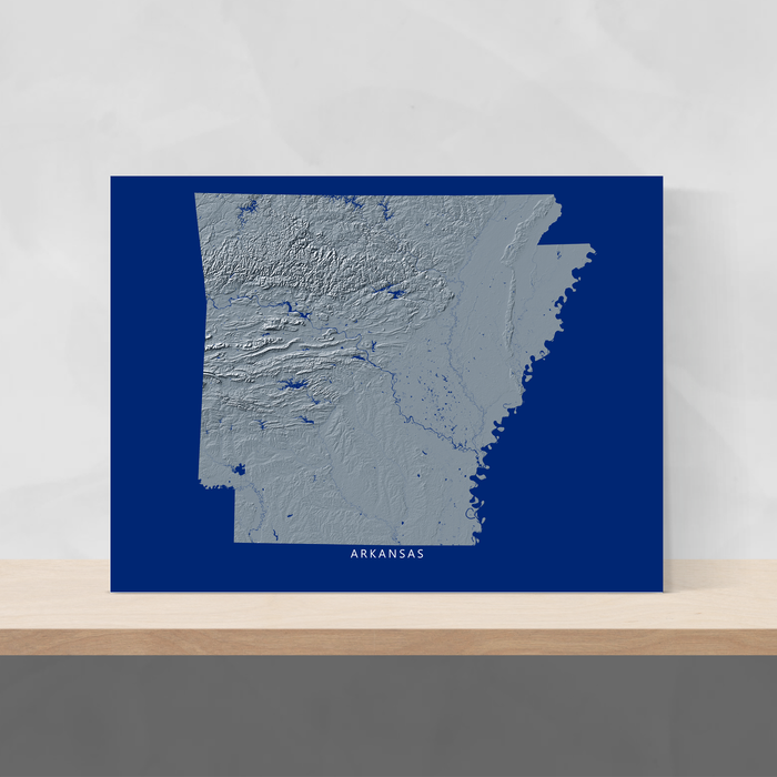 Arkansas state map with natural landscape in greyscale and a navy blue background designed by Maps As Art.