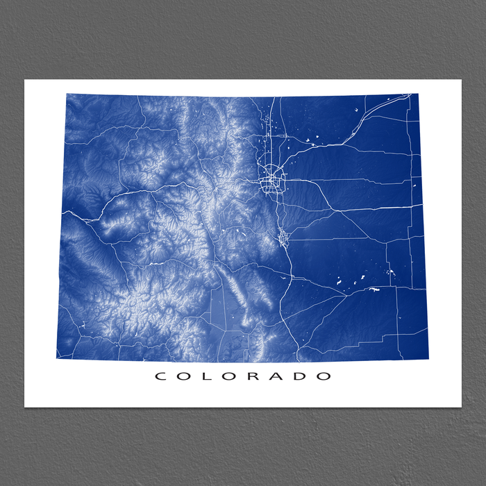 Colorado state map print with natural landscape and main roads in Navy designed by Maps As Art.