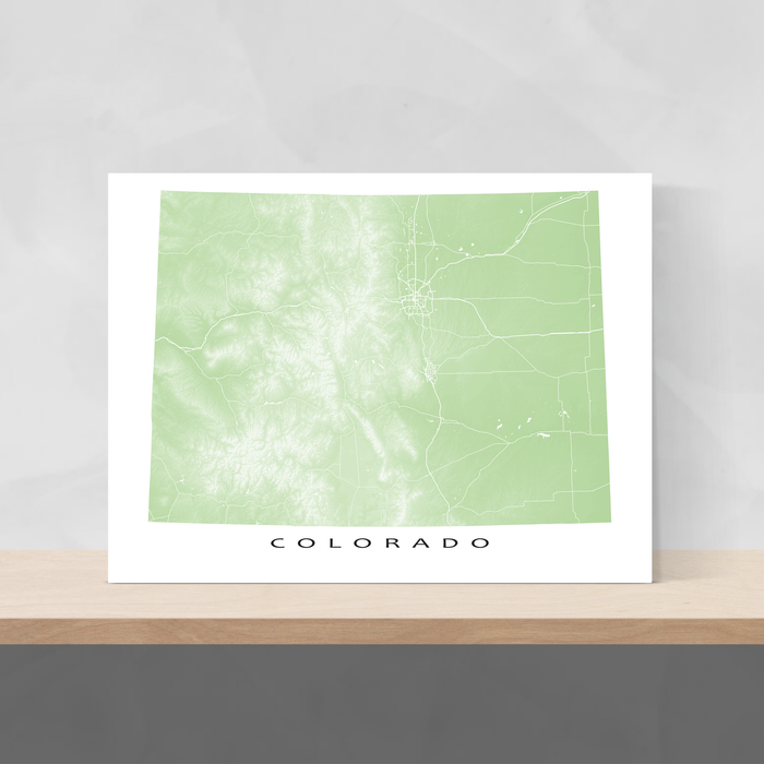 Colorado state map print with natural landscape and main roads in Sage designed by Maps As Art.
