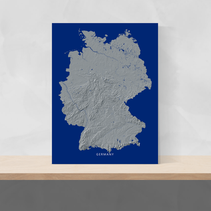 Germany map print with natural landscape in greyscale and a navy blue background designed by Maps As Art.