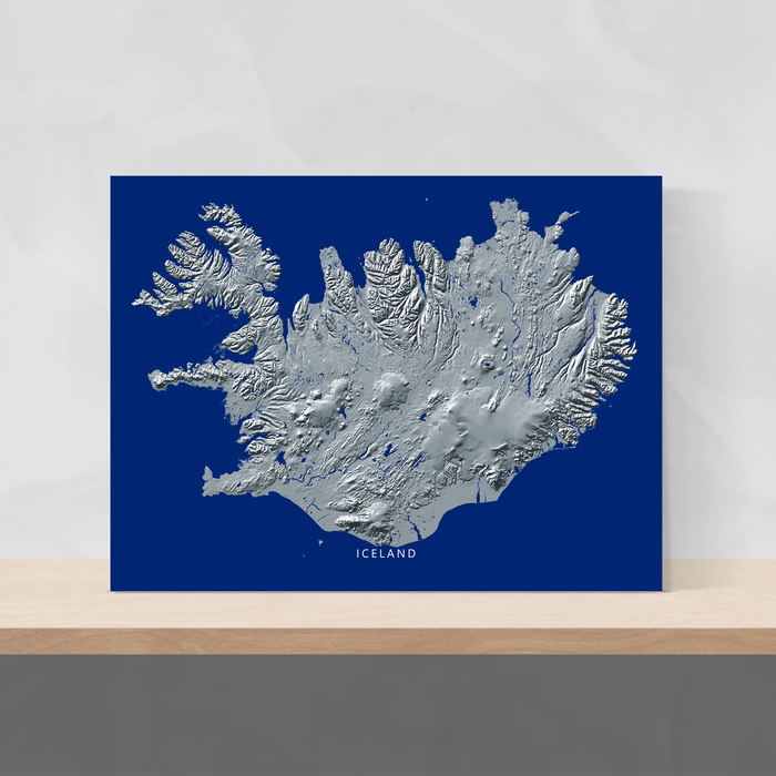 Iceland map print with natural landscape in greyscale and a navy blue background designed by Maps As Art.