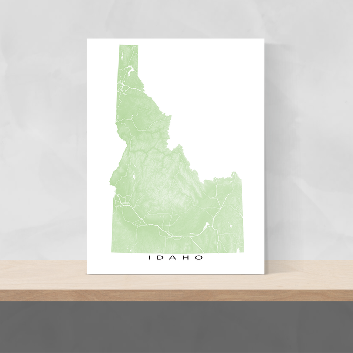 Idaho state map print with natural landscape and main roads in Sage designed by Maps As Art.