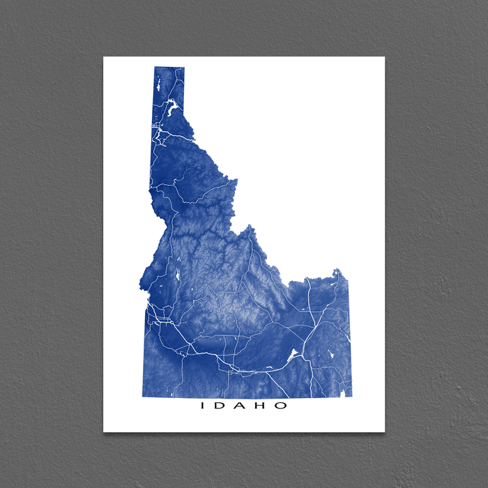 Idaho state map print with natural landscape and main roads in Navy designed by Maps As Art.